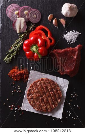 Raw Beef Burger Steak Cutlets With Ingredients. Vertical Top View