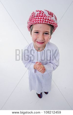 Praying arabic boy.