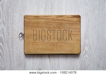 Wooden Chopping Board On Brushed White Table Top View