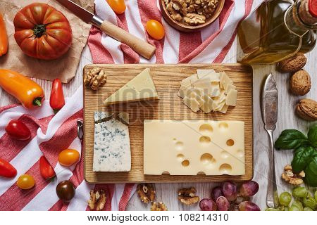Cheese Plate With Vegetables And Suppliers Top View