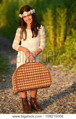 girl carrying vintage picnic basket