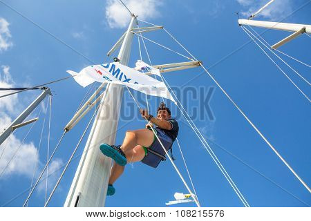 HYDRA, GREECE - CIRCA OCT, 2014: Sailor participate in sailing regatta 12th Ellada Autumn 2014 among Greek island group in the Aegean Sea, in Cyclades and Argo-Saronic Gulf.