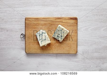 Gorgonzola, Roquefort, Soft Cheese With Green Moss Isolated On Brown Desk On Brushed White Table Top