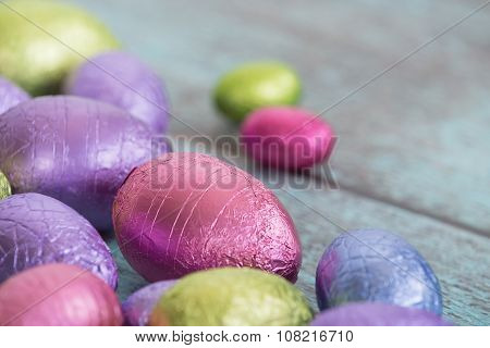 Easter Chocolate Eggs On Vintage Green Background