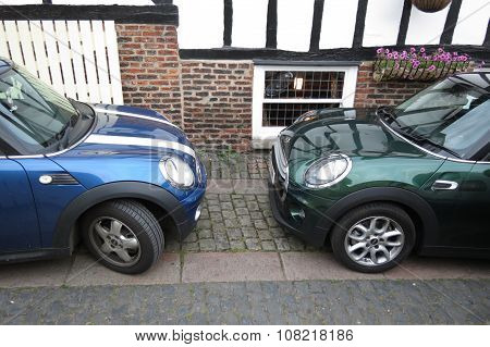 YORK UK - CIRCA AUGUST 2015: blue Mini Cooper car (new model produced from 2013 onwards) facing a green one