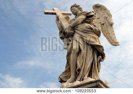 ROME, ITALY - FEBRUARY 27: Bernini's angel along the Holy Angel bridge near the Hadrian Mausoleum in Rome, Italy on February 27, 2010