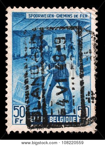 BELGIUM-CIRCA 1945: A stamp printed in Belgium shows Box-shipper from The Railway Company at Work issue, circa 1945.
