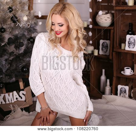 Blond Woman Wears Cozy Knitted Cardigan,posing Beside Christmas