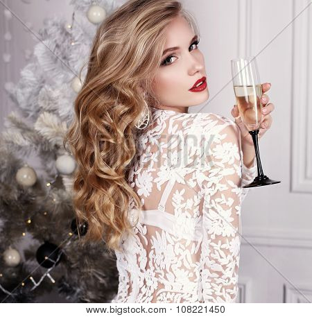 Girl With Blond Hair Wears Luxurious Dress,posing Beside Christm