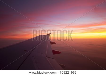 Beautiful Sunrise out of Plane Window