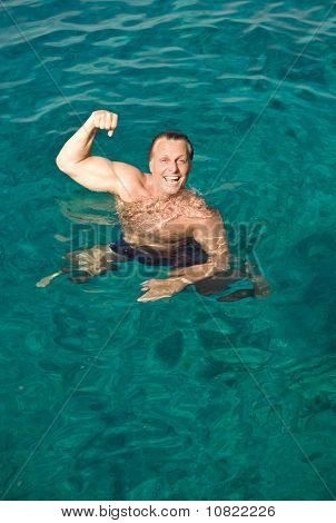 happy laughing man posing in the water