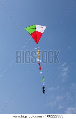 Colorful Kite Flying In A Beautiful Blue Sky
