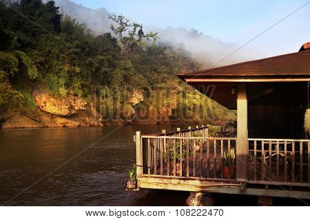 Hut near river and mountain in Thailand at morning