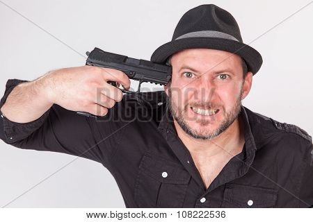 Angry Young Man Pointing Gun To His Head