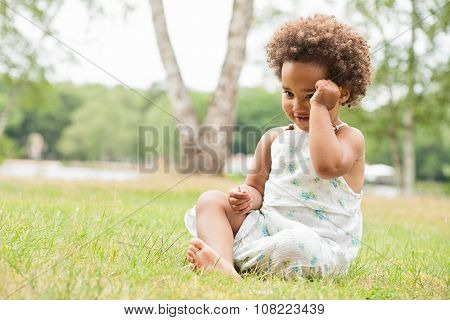 African Girl On The Grass