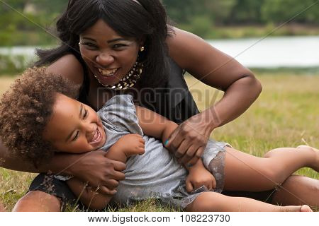 African Mother Is Playing With Her Girl