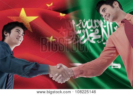 Chinese Man Shaking Hands With Arabian Person