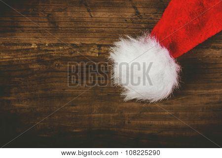 Retro Toned Santa Claus Hat On Wooden Desk