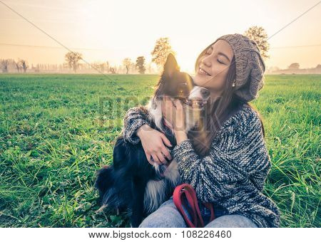 Woman Plays With Her Dog