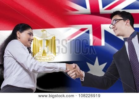 Egyptian Woman Shaking Hands With Australian Person