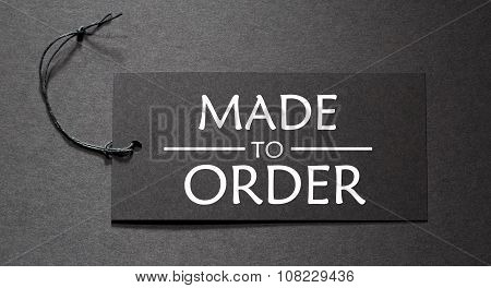 Made To Order Text On A Black Tag