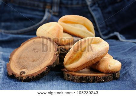 Homemade Puff Cookies On Wooden Stands On Jeans Cloth