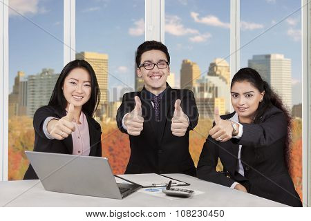 Group Of Multi Ethnic Workers Show Thumbs Up