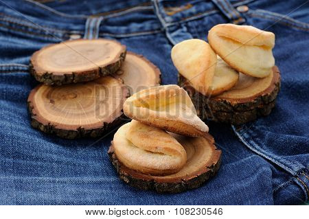 Homemade Puff Cookies On Wooden Stands On Old Jeans