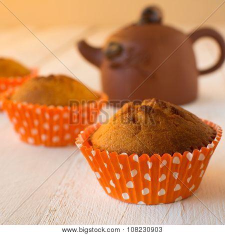 Muffins And Ceramic Teapot
