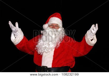 Santa Claus with his arms raised