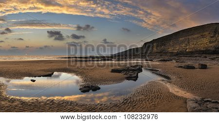 Stunning Vibrant Panorama Sunset Landscape Over Dunraven Bay In Wales