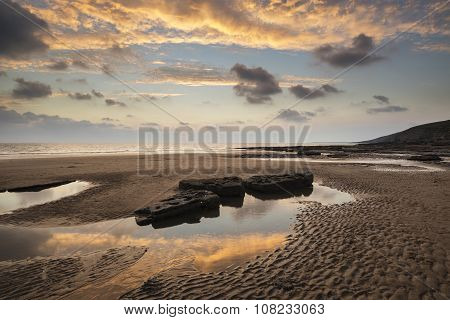 Stunning Vibrant Sunset Landscape Over Dunraven Bay In Wales