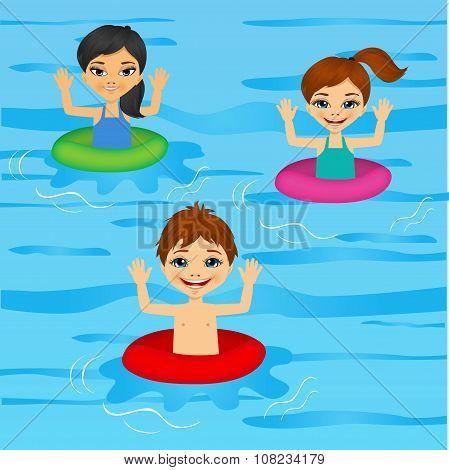 three cute little kids swimming