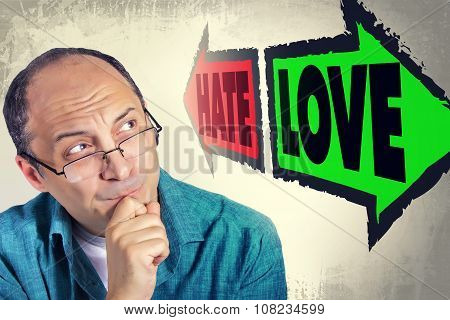 Portrait Of Adult Man Faced With Choice Between Hate And Love