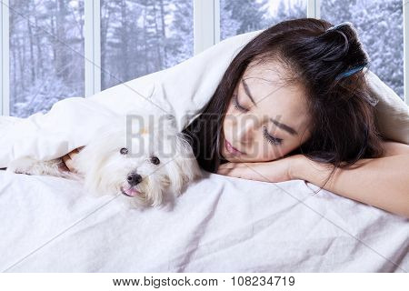 Pretty Girl And Her Dog Sleeping On The Bed