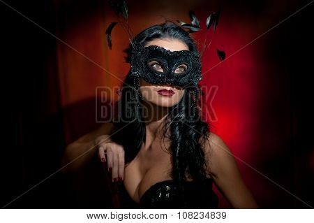 Portrait of attractive sensual young woman with mask, indoors. Sensual brunette lady posing