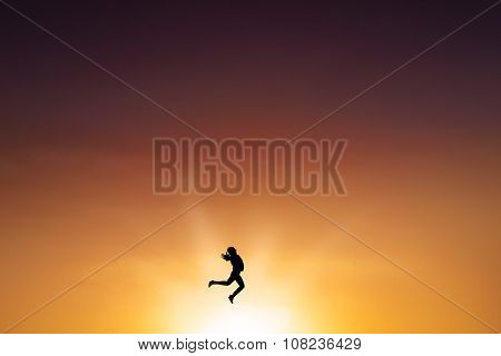 Successful Woman Leaps On The Air At Dusk Time