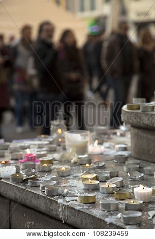 LYON-FRANCE NOVEMBER 15, 2015: People light candles on the steps of the town hall at Lyon, France after the terrorist attacks in France