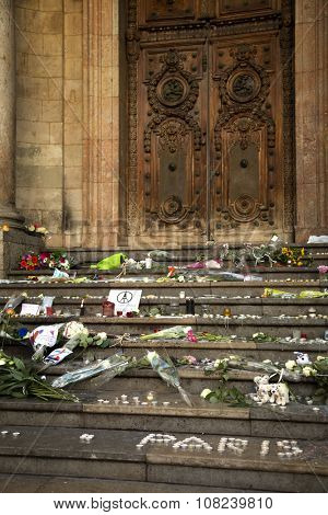 LYON-FRANCE NOVEMBER 15, 2015:  Offerings, toughts, flowers and candles on the steps of the town hall at Lyon, France after the terrorist attacks in France