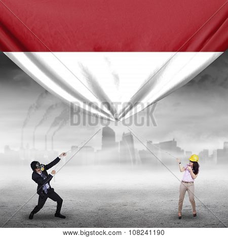 Two Workers Pulling Indonesian Flag