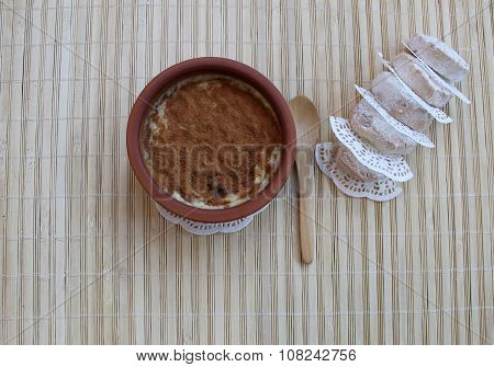 Milk rice pudding, baked in the oven, sprinkle top with cinnamon, Turkish dessert syutlach