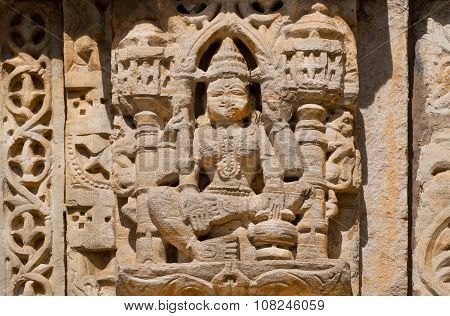 Stone Relief With Hindu God On The Front Of Indian Temple