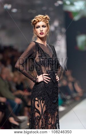 ZAGREB, CROATIA - OCTOBER 31, 2015: Fashion model wearing clothes designed by Ivica Skoko on the 'Fashion.hr' fashion show