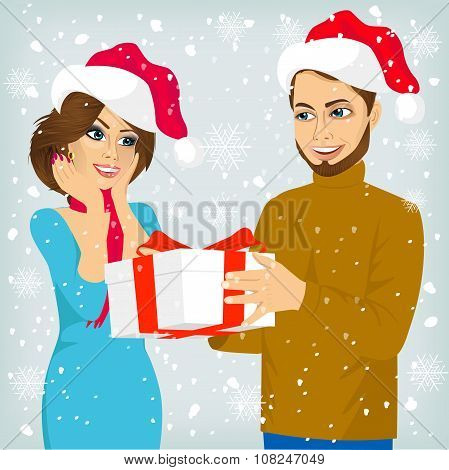 man and woman with christmas present