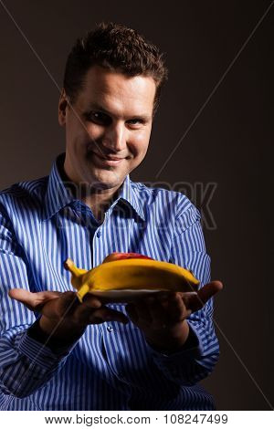 Diet Nutrition. Happy Young Man Holding Fruits.