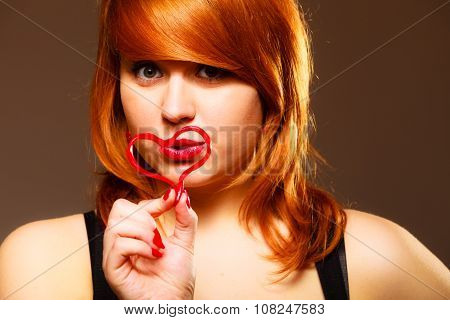 Woman Creating Heart Symbol.