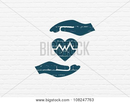 Insurance concept: Heart And Palm on wall background