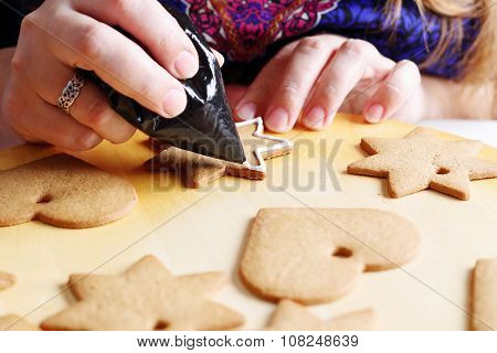 Decorating gingerbread cookies.