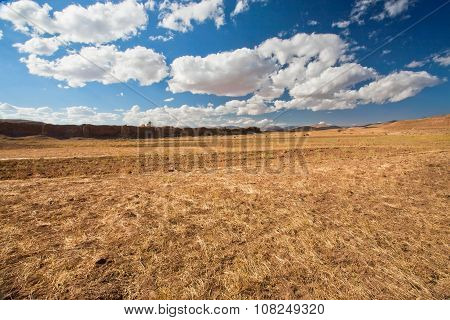 White Clouds Floating Over Dry Grass Land Of Plateau