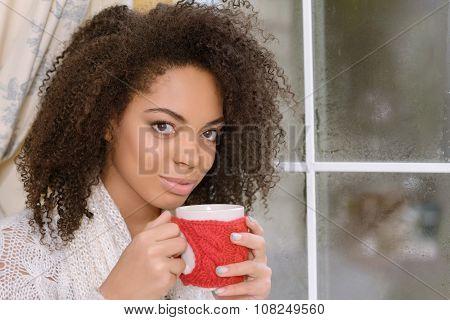 Nice girl sitting near window